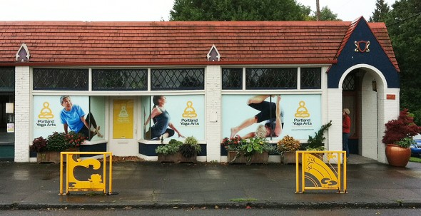 exterior view of yoga studio showing large photo murals by John Valls